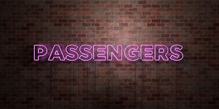 PASSENGERS - fluorescent Neon tube Sign on brickwork - Front view - 3D rendered royalty free stock picture Stock Photos