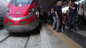 Passengers get off the train and head to the station exit. Naples, Italy - May 16, 2017: The high speed passenger train just arrived at the Central Train Station stock video