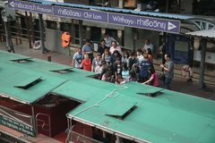 Passengers getting in a ferry boat at Chit lom Pier stock images