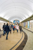Passengers go through a transition of the subway station Stock Images