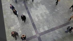 Passengers go through an underpass top view stock video