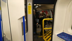 Passengers going to the door. train doors close. London. England. United Kingdom. View from the train. People rush to the exit. The doors close and the train stock video