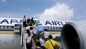 Passengers going up the plane Stock Photography