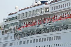 Passengers while greeting from cruise ship sets sail from the po Stock Images