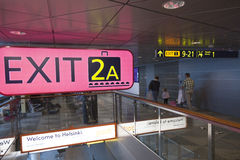 Passengers at helsinki vantaa airport near sign of exit and bagg Stock Image