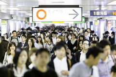 Passengers hurry at Ikebukuro station in Tokyo, Japan Stock Photography