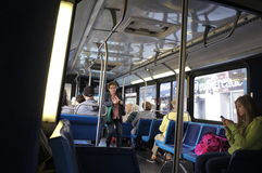 Passengers inside an MTA bus. Passengers inside a bus commuting to their destination in New York City Royalty Free Stock Photos