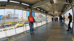 Passengers inside the station waiting for the Transmilenio. Transmilenio is the service of mass transit in the city of Bogota Royalty Free Stock Photo