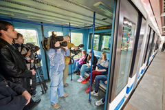 Passengers and journalists in carriage of Moscow monorail system Royalty Free Stock Photography