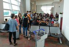 Passengers at KLIA airport, Malaysia. Passengers waiting for boarding at KLIA airport in Malaysia. KLIA is the largest and busiest airport in Malaysia. KLIA Stock Photography