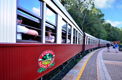 Passengers on Kuranda Scenic Railway in Queenland Australia. CAIRNS, AUS - APR 17 2016:Passengers on Kuranda Scenic Railway a very popular tourist attraction in royalty free stock photos