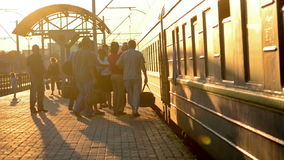 Passengers landing at a passenger train. Train Station, Belaya Tserkov, Ukraine - July 31, 2015. Many people make the passengers landing in a passenger train at stock footage