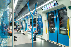 Passengers in the latest MRT Mass Rapid Transit. MRT is the latest public transportation system in Klang Valley from Sungai Bul. Kuala Lumpur,Malaysia - July 25 stock photography