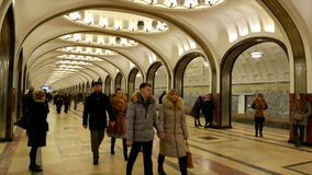 Passengers leave the train at the subway station Mayakovskaya in Moscow. MOSCOW, RUSSIA. 17 JAN 2015. Mayakovskaya subway station. Editorial video. Shooting in stock video footage