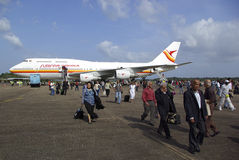 Passengers leaving plane. Passengers depart aeroplane and walk to the arrival terminal to check in to Suriname Royalty Free Stock Image