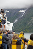 Passengers of liner photograph Geyranger Fjord Royalty Free Stock Photos