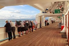 Passengers lining the railings of a cruise liner royalty free stock image