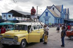 Passengers loading a collectible taxi in Cuba. Passengers loading a collectible taxi at Bus and train station in Matanzas, Cuba Royalty Free Stock Photo
