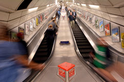 Passengers on London Underground escalator. LONDON, UK - MAY 12 2015:Passengers on London Underground escalator. The Deepest station below street level Royalty Free Stock Photos