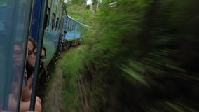 Passengers looking out of window on train journey through tea estates, Kandy stock video footage