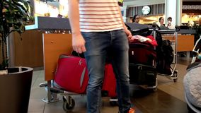 Passengers with luggage at food court inside YVR airport. In Vancouver BC Canada stock video footage