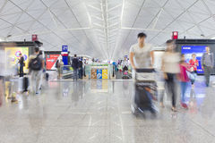 Passengers with luggage in the Hong Kong International Airport Royalty Free Stock Image
