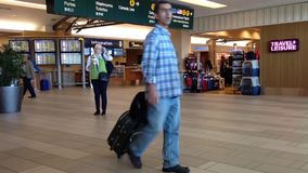 Passengers with luggage inside YVR airport stock video footage