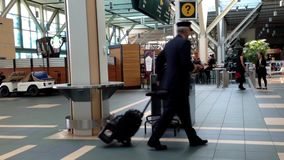 Passengers with luggage inside YVR airport. In Vancouver BC Canada stock video footage