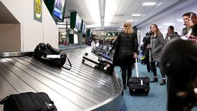 Passengers with luggage inside YVR airport. In Vancouver BC Canada stock video