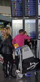 Passengers with luggage, Malaga airport. Royalty Free Stock Images