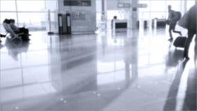 Passengers with luggage walking in  Zurich-Kloten Airport stock video footage