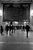 Gare du Nord Commuters and Schedule Board. Passengers make their way through Gare Du Nord. Gare du Nord is the station for trains to Northern France, Belgium Royalty Free Stock Photo