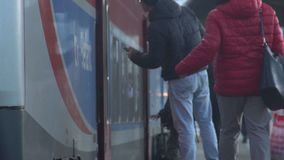 Passengers making haste to the train, the long-awaited journey, slow-motion. Stock footage stock footage