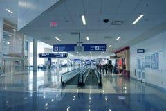 Passengers in Modern Airport Stock Image