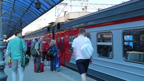 Passengers on Moscow passenger platform (Yaroslavsky railway station), Russia. Is one of nine main railway stations in Moscow, situated on Komsomolskaya stock footage