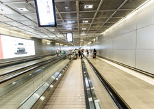 Passengers on a moving walkway in the airport Stock Images