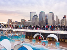 Passengers on MSC Poesia viewing Manhattan. Passengers on walkway deck of cruise ship MSC Poesia viewing Manhattan skyline.  The Manhattan skyline is one of the Stock Photos