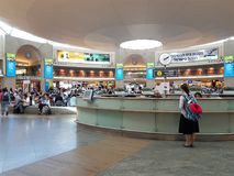 Passengers near the information desk, clock and the departure bo Stock Photo