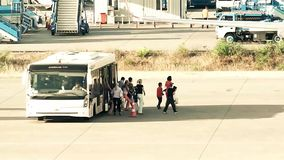 Passengers off the bus for boarding an aircraft stock footage