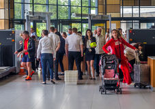 Passengers pass the inspection of security service at the entrance of the city Simferopol Airport Royalty Free Stock Image