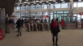 Passengers pass through the turnstiles at the new station Kutuzovskaya of Moscow Central Circle stock footage
