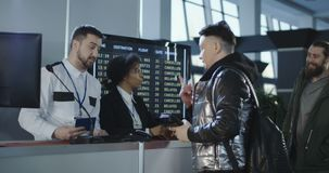 Passengers passing inspection at check point stock video footage