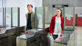 Passengers passing the turnstile Stock Image
