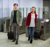 Passengers passing the turnstile Stock Photography