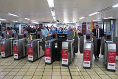 Passengers passing turnstiles Stock Photos