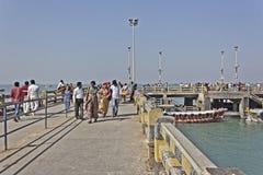 Passengers on pier Royalty Free Stock Image