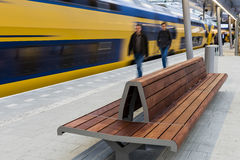 Passengers on Platform with Bench Stock Photos
