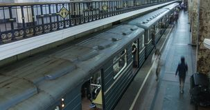 Passengers on the platform board the train. Moscow metro station Komsomolskaya. Surveillance camera in the foreground. Moscow, Russia. 4k timelapse stock footage
