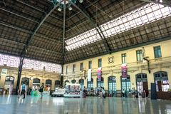 The passengers platform and railways of the Estacion del Nord, Valencia train station in Spain. Valencia, Spain - July 5th, 2018: The passengers platform and royalty free stock image