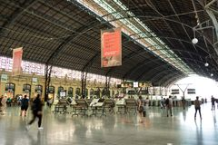 The passengers platform and railways of the Estacion del Nord, Valencia train station in Spain. Valencia, Spain - July 5th, 2018: The passengers platform and stock photos